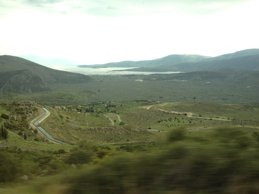 The small gray-green lumps visible in this shot from the bus are some of the 9 million olive trees that grow throughout the valley near the Itea Gulf
