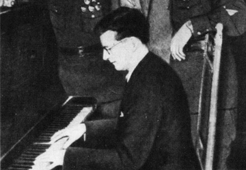 Shostakovich plays for bomber pilots below picture of Stalin